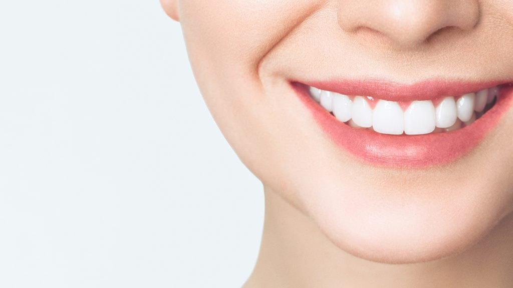 perfect healthy teeth smile of young woman