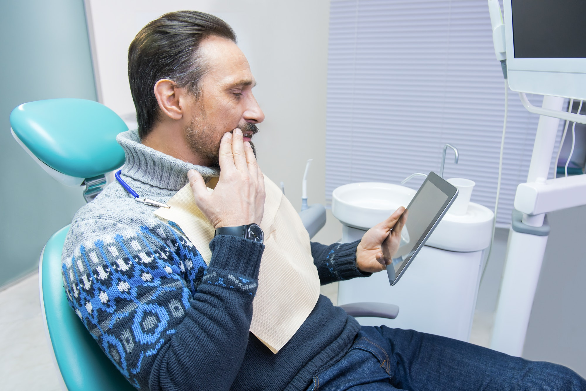 Adult man in dental office